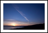Contrail at sunset
