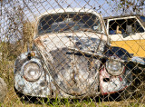 VW behind fence