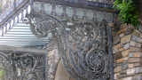 Elaborate metal designs on the porte cochère at the front of the mansion.