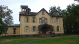 Architect Upjohn painted the brick yellow and brown and added the 4-1/2 story Italianate tower to break up the symmetry.