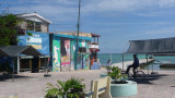 A typical San Pedro scene with shops and the Carribean Sea in the background.