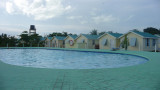 Pool and cottages at the Royal Caribbean Resort.