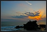 Sunset on the rocky temple of Tanah Lot.