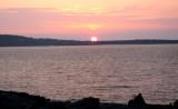 A sunset over 3 islands