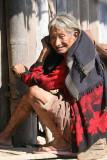 Khiamniungan Naga lady in Nokyan with tattoos on her legs.