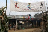 Mickey Mouse, Holy Mary and Hornbill together on a banner in Wanching.
