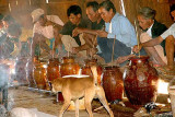 Before the rice wine is tasted, the Kreung people speak a short prayer. Kameng, Cambodia.