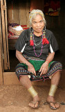 One of the last Phnong ladies with brass anklets on her legs. The Red Khmer forbade and destroyed these traditional rings.