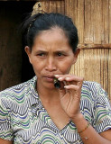 Many Phnong ladies like to smoke home-made cigars. Pu Tang Village, Mondulkiri, Cambodia