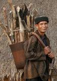 Phnong men care for firewood. Pu Tang Village, Mondulkiri, Cambodia