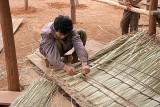 Every one or two years a traditional Phnong house needs a new roof. Pu Lang Village II, Mondulkiri, Cambodia