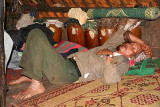 Phnong man taking a nap next to his jars with rice wine. Pu Tang village, Mondulkiri, Cambodia