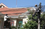 Repair of power cables in Seam Reap, Cambodia.