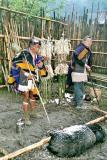 Myoko Priest and pig. Apatani tribe
