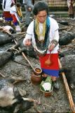 Myoko. Rice wine is poured over the pigs. Apatani tribe