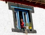 Nun in a window in Kungri Spiti