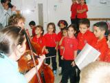 Children with Violinist  at Music Festival in 2005  to Acquaint the Children With Instruments and Classical Music