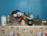 still life with old kitchen table and plastic roses