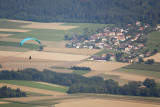 Paraglider in front of the village of Saules
