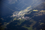 Town of Grimentz across the valley, lit through the clouds.