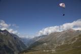 Mom paragliding above, in Zermatt.