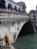 Playing tourist standing in front of the Rialto Bridge