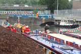 The opening barge arrives