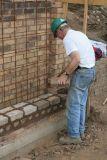 Alan tying in to the original brickwork ...
