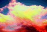 I see the morning sky light up like flames.