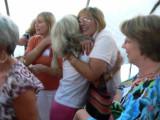 Susan Booth hugging Debbie Bauman