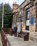 Carole outside her first school now a library