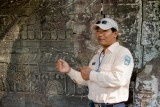Our guide explaing the bas-relief murals which depict the history of Cambodia