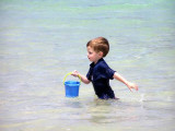 Kid playing on Cockleshell Beach