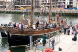 The Zebu moored in front of the new Titanic Quarter development