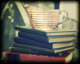 books with pink depression glass pitcher