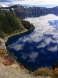 Deep blue water and clouds on north rim
