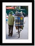 Household Goods Vendor on Bike