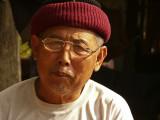 Man in village in Northern Laos.jpg