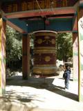 Spin the mani (large prayer wheel).