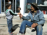 Turning a prayer wheel with Dorje-Uncle.