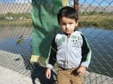 Rahil and prayer flag at fish pond.