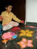 Making rangoli (colored powder decorations) with Mom on Diwali