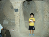 In the creepy underground city of Kaymakli, in front of a round stone used to seal the passage.