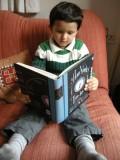 Rahil enjoying The ACME Novelty Date Book (1995-2002)
