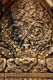Kubera, God of the North, supported by simhas (lions)