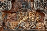 multi-headed demon Ravana shaking Mount Kailasa, where Shiva and Uma are seated