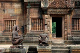 a pair of kneeling guardian figures,; the bodies were human, but the heads varied - monkey, lion, garuda and yaksha