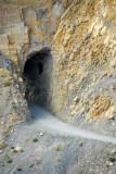 Road blasted through a narrow tunnel