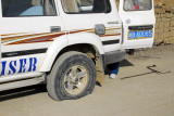 Flat Tire! To be honest, I'm amazed the ancient Land Cruiser made it this far