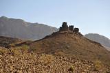 Castle-like rock formation along the road to Jabal Shams